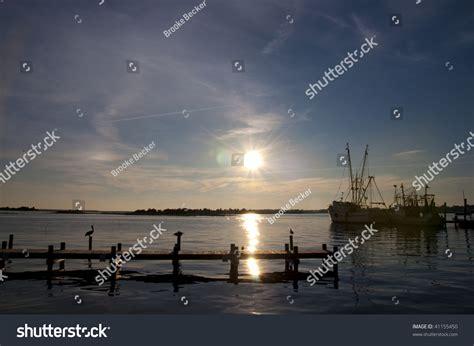 pelican boats website pelicans and shrimp boats at dusk in swansboro north