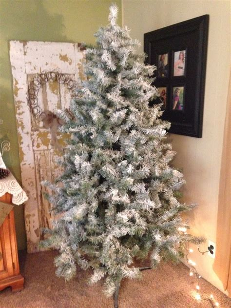 flocked christmas tree couple  cans  white spray