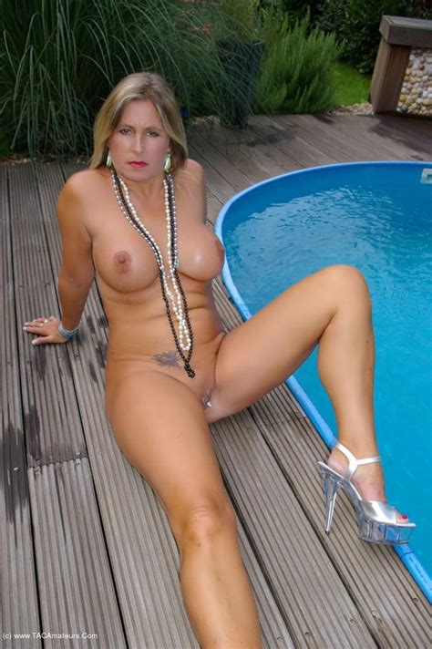 Nude Chrissy Relaxing By The Pool Showing Her Pussy