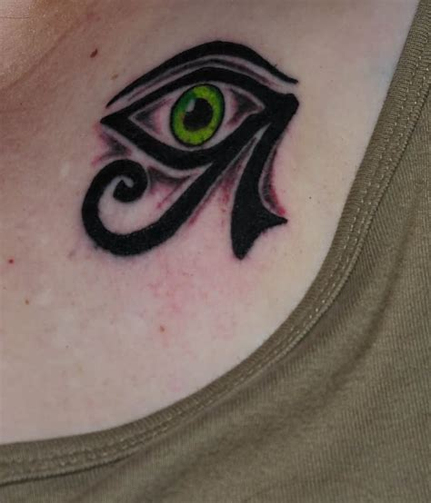 eye tattoo green green eye egyptian tattoo on collarbone