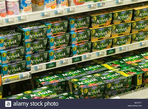 Shelf Of Yogurt by Containers Of Dannon Activia Yogurt Are Seen On A
