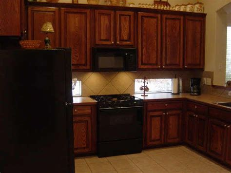 kitchens with black appliances and oak cabinets black appliances with oak cabinets do you like the ss or