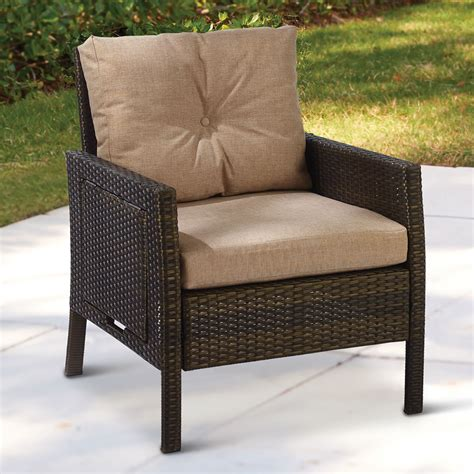 outdoor wicker armchair the side tabled outdoor wicker armchair hammacher