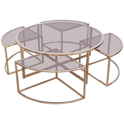 brass coffee table with four nesting tables by