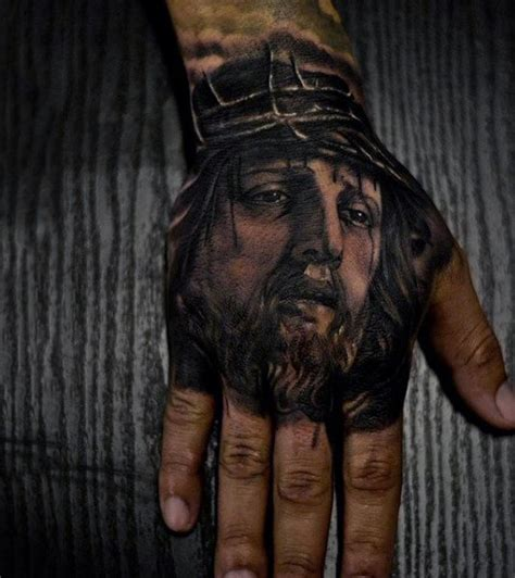 jesus tattoo using hand 100 jesus tattoos for men cool savior ink design ideas