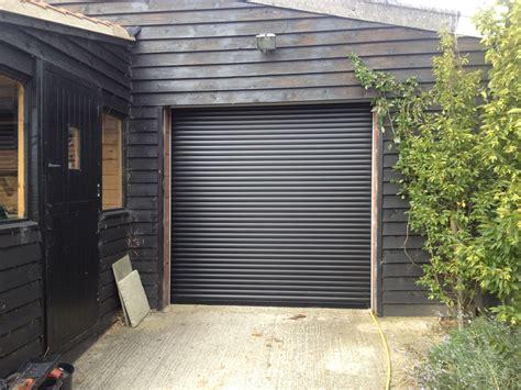 black roller garage door installed in hull