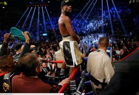 16 go yurt cing punching moments in the face in moment of triumph mayweather fights off boos from