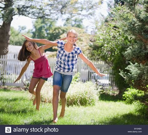 free backyard porn usa new york two girls 10 11 10 11 playing in backyard stock photo royalty free