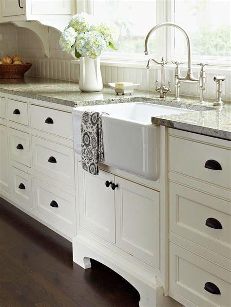 sink backsplash white cabinets white gray granite big over sink window