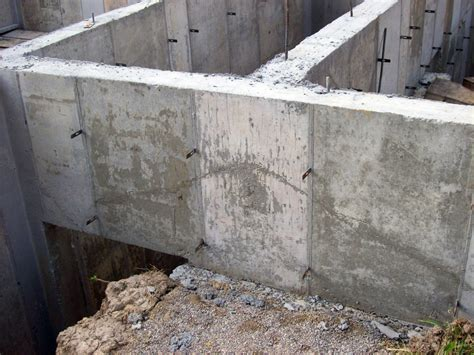 think of poured concrete walls as structural beams