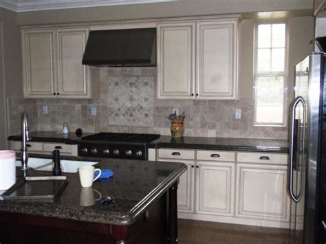 painted kitchen cabinet colors ideas with white cabinet black island and countertop and ceramic