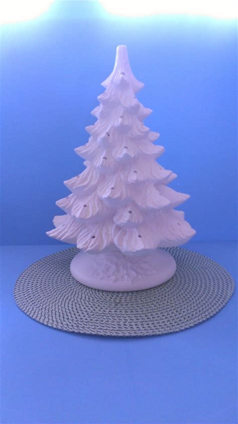 ceramic unpainted medium pine christmas tree with holly
