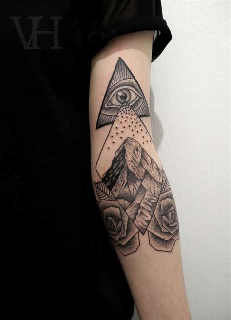 modern ink tattoo ink arm black black abstract eye mountain