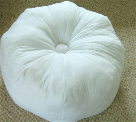 Gum Drop Pillows by Philigry A White Tufted Gumdrop Pillow