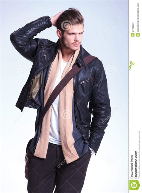 Happy Times Jaket Hax in leather jacket is looking away to his side and smiles stock image image 34923535