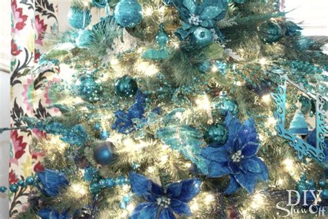white christmas tree with royal blue decorations blue