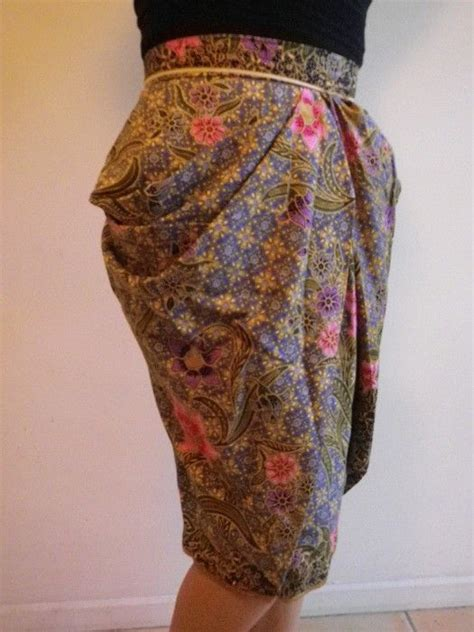 Kebaya Muslim Tribal s striking batik green blue floral tulip
