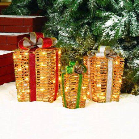 sylvania 3 piece lighted gift box set christmas outdoor yard decor time glittering gold pvc grapevine tappered gift box light sculpture 3 set