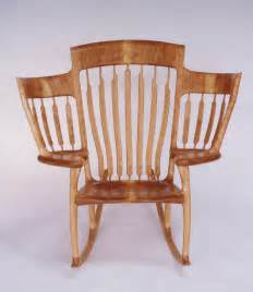 a wooden three seater storytime rocking chair designed