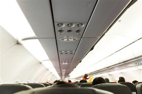 no smoking sign plane no smoking and fasten seat belt sign on airplane photo