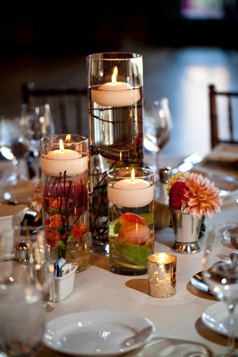 floating candle wedding centerpiece with submerged flowers