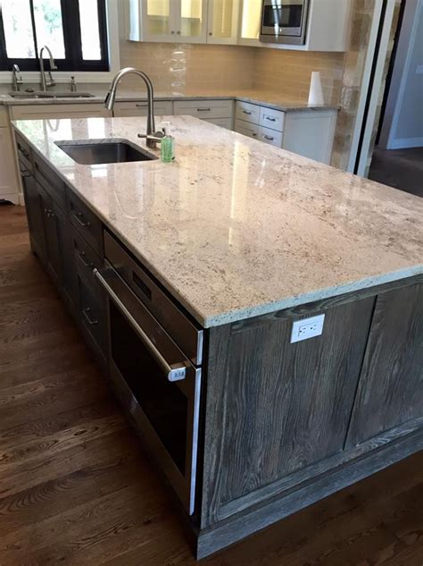 granite countertops with light cabinets light granite river white granite kitchen island