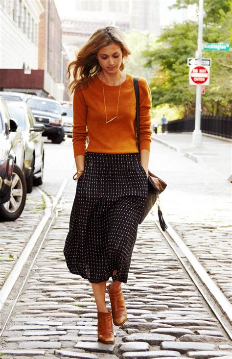 picture of patterned midi an ocher sweater and boots for