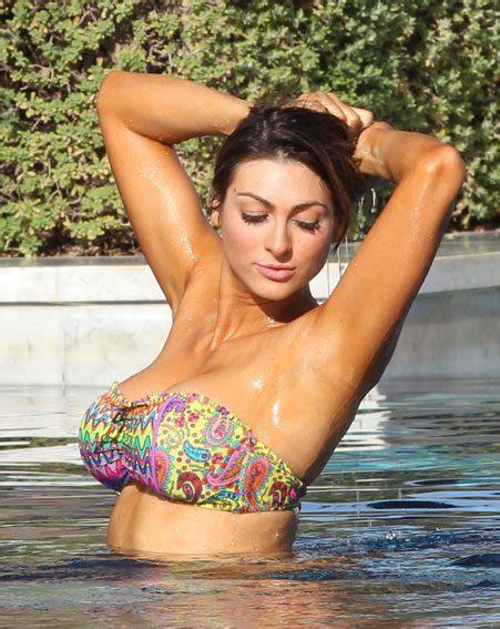 luisa zissman nearly falls out of her very low cut dress luisa zissman shows off amazing bikini body has no idea