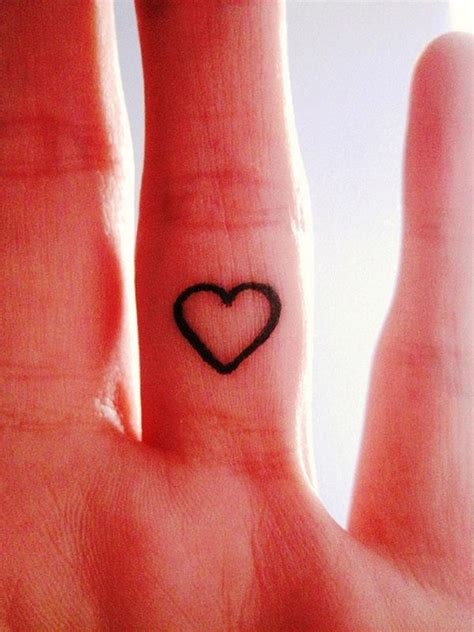 small heart outline tattoo 60 cool tattoos on fingers