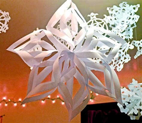 paper snowflake decorations host the toast