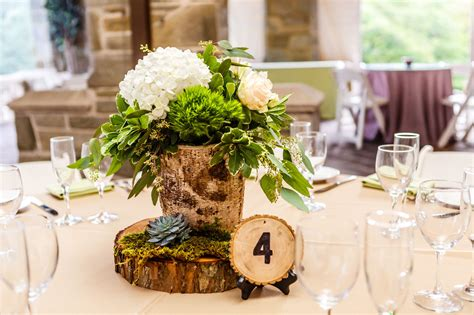 wood centerpiece birch wood centerpieces with hydrangeas and greenery and wood slab table numbers