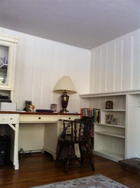 paint wood paneling white wood paneling and bookshelves