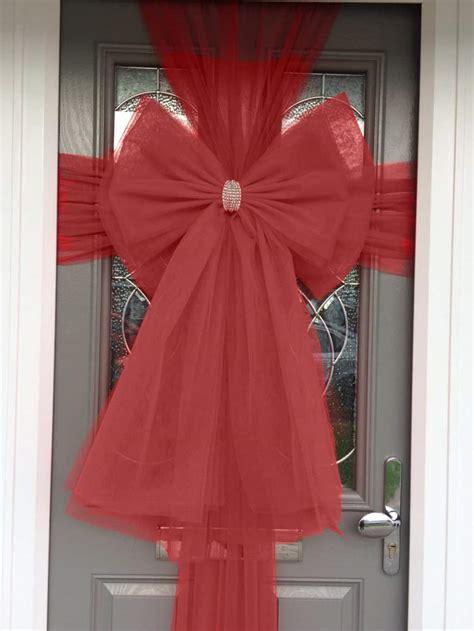 door bows find  pin    christmas door bows