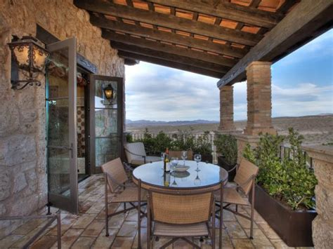 mediterranean style outdoor dining room   covered