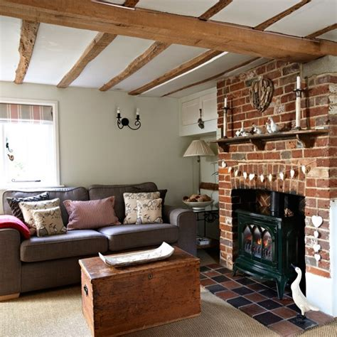 cream walls and exposed beams housetohome co uk country living room with wooden beams and exposed brick