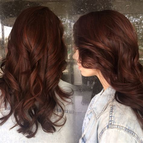 what is in style in highlight auburn brunette with subtle red highlights peaking through