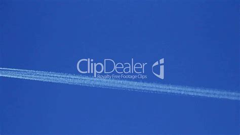 airplane vapor trails against a clear blue sky 1 royalty