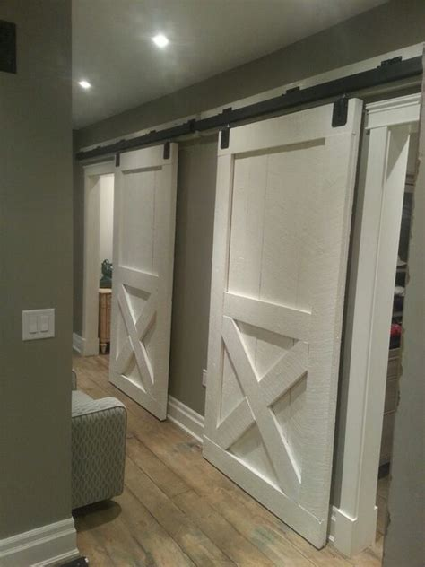 sliding barn door bedroom diy our new sliding barn doors for the bedrooms rough cut