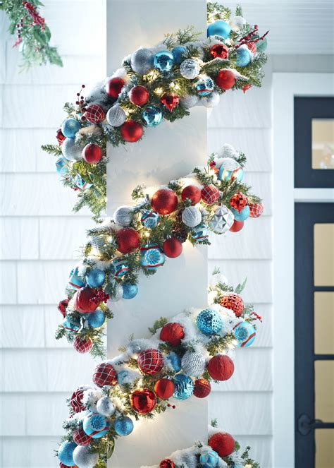 outside garland add shatterproof ornaments with wire to pre lit garland for an easy outdoor diy get more from