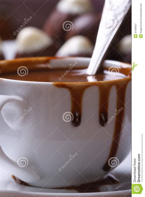 Liquid Chocolate Mr Milt liquid chocolate is splashed out cup closeup vertical royalty free stock photography image