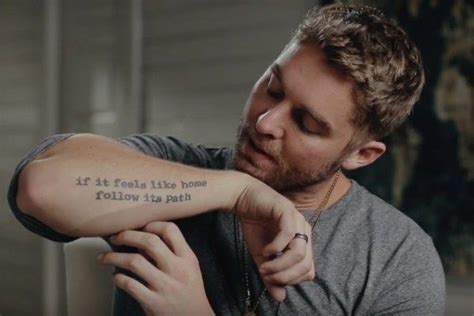 tattoo meaning youth brett young explains the meaning behind his tattoos watch