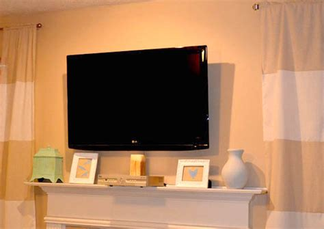 tips for hanging a flat screen tv over a fireplace remodelaholic wall mount your flat screen tv for under