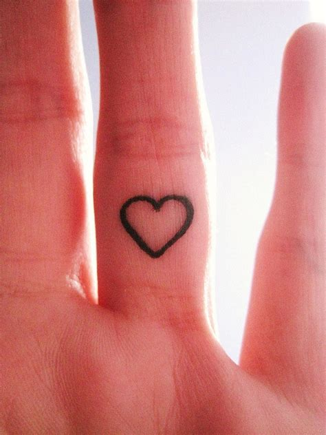heartbeat tattoo on finger cute heart finger tattoo for girls tattooshunt com