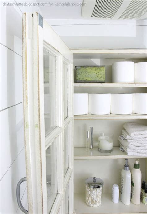 remodelaholic bathroom storage cabinet    window