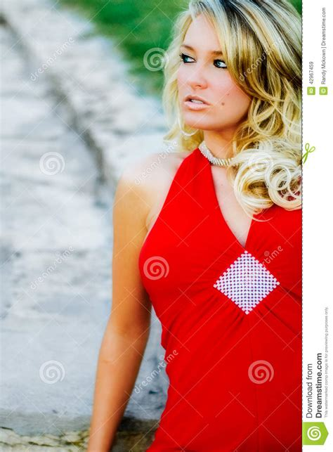 sexy woman blond hair stock photography image 10097442 woman blonde model in formal red dress stock photo