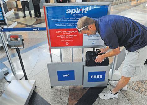 spirit baggage fees spirit airlines begins denver service amid furor over fees