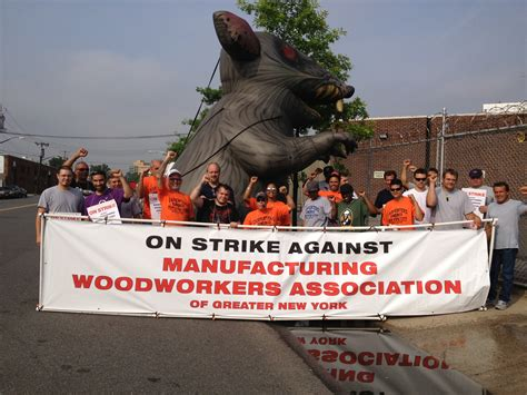 woodworkers union carpenters continue strike against manufacturing