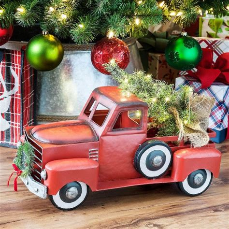truck and station wagon with lit tree and wreath for sale