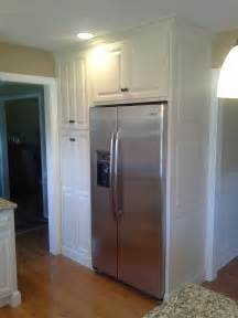up of stainless steel refrigerator and white painted