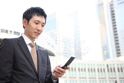 japanese free mobile japanese businessman with a mobile phone stock photos